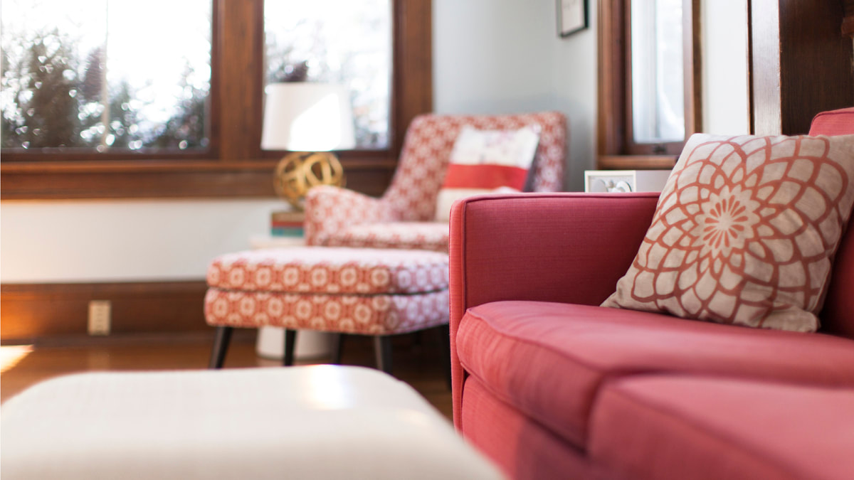 Red couch and red patterned chair