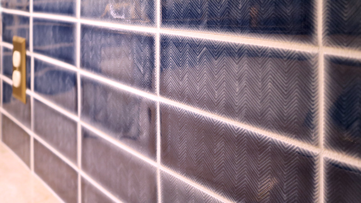 Handmade blue chevron patterned backsplash tile